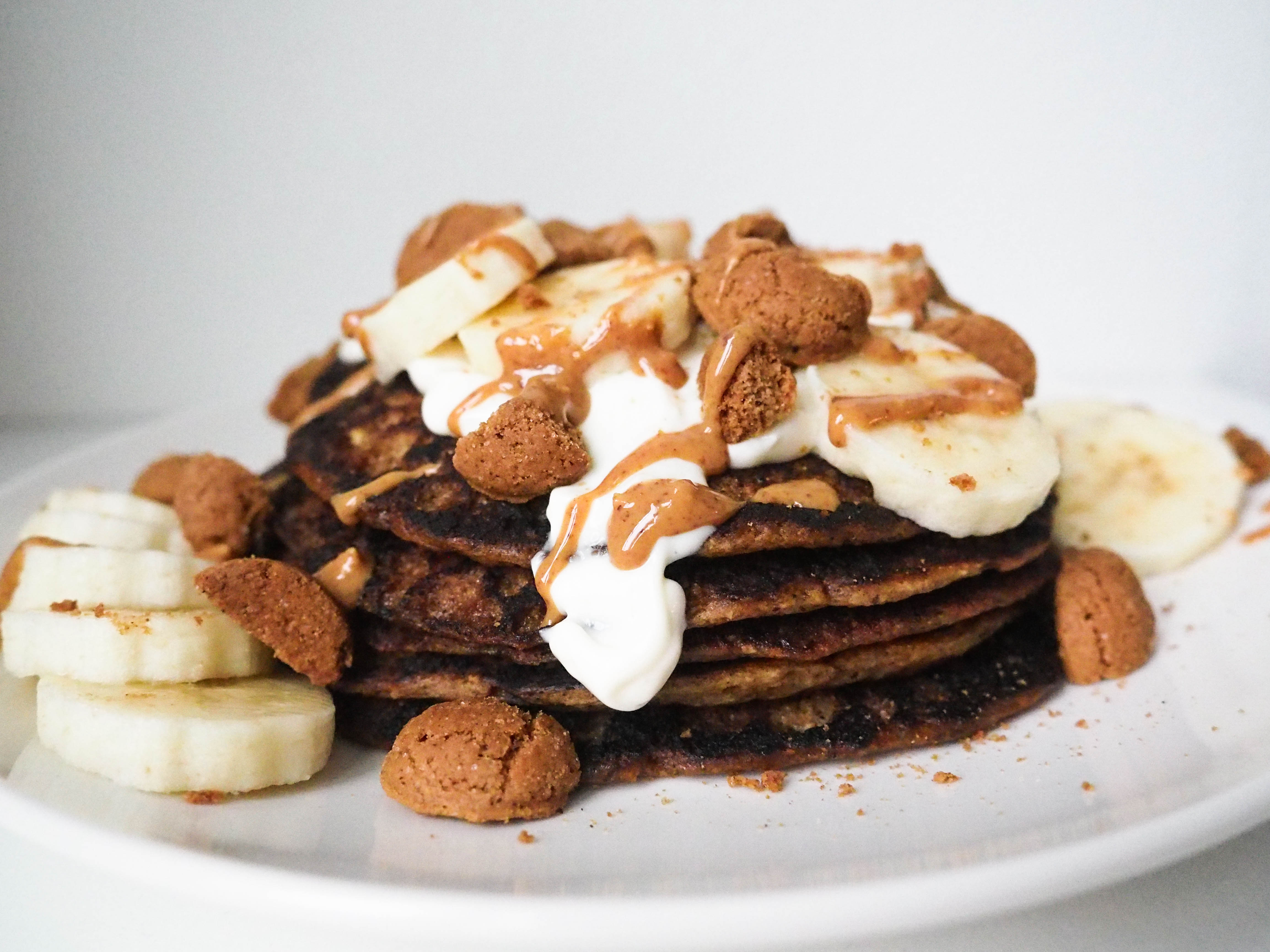 Pepernoten Pancake Stack with Quark, Peanut Butter Drizzle and Banana Slices